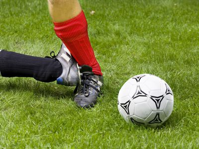 Soccer player getting his ankle kicked