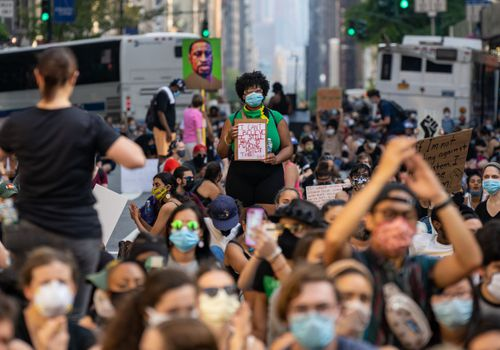 Protesters in New York City march down Fifth Avenue