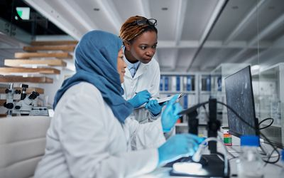 Pathologist and lab professional discuss biopsy findings