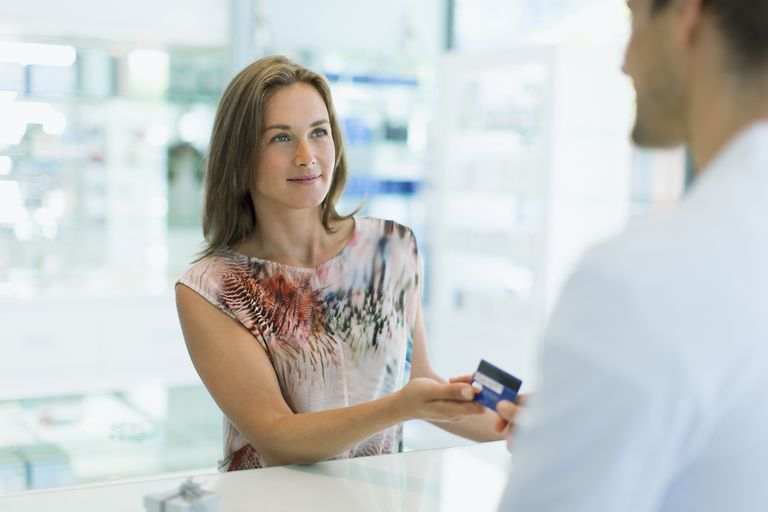 woman paying for medical care