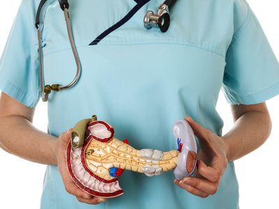 Nurse with pancreas on white