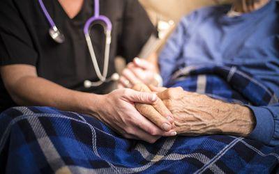 Nurse with older patient.