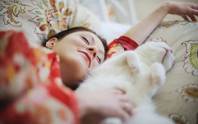 A woman experiences sleep inertia to stay asleep in the morning past her desired wake time and search for fixes, cures, and treatments