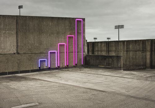 neon sign of a bar graph on concrete