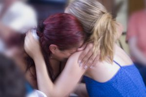 young women hugging who are experiencing anticipatory grief