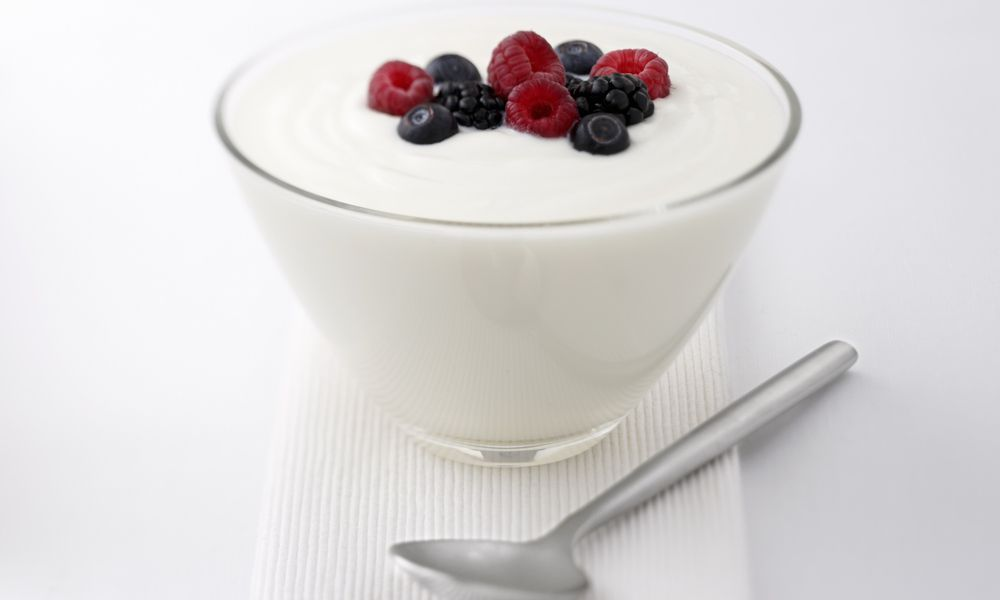 bowl of yogurt with berries on top
