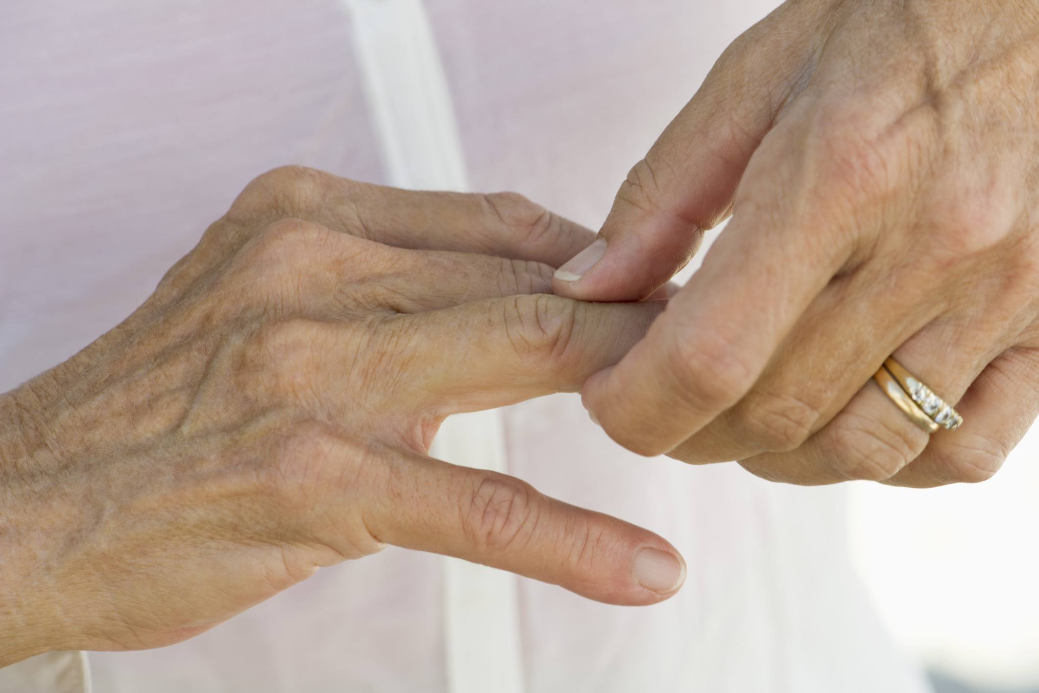 Woman cracking knuckles on hand