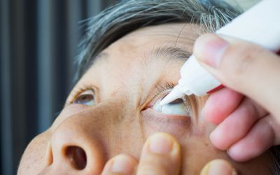 Person getting artificial tears for dry eyes