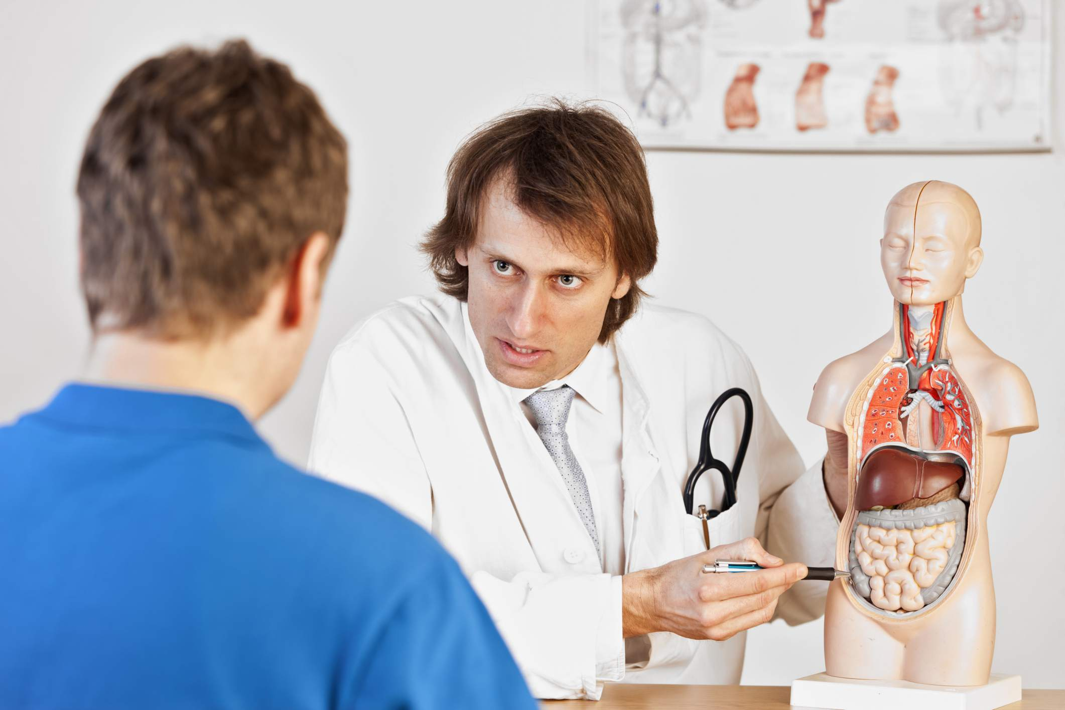 Doctor Explaining Pain to patient with intestine model
