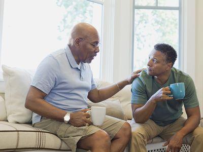 senior man talking to middle aged man