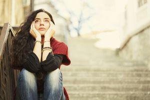 sad woman sitting on stairs
