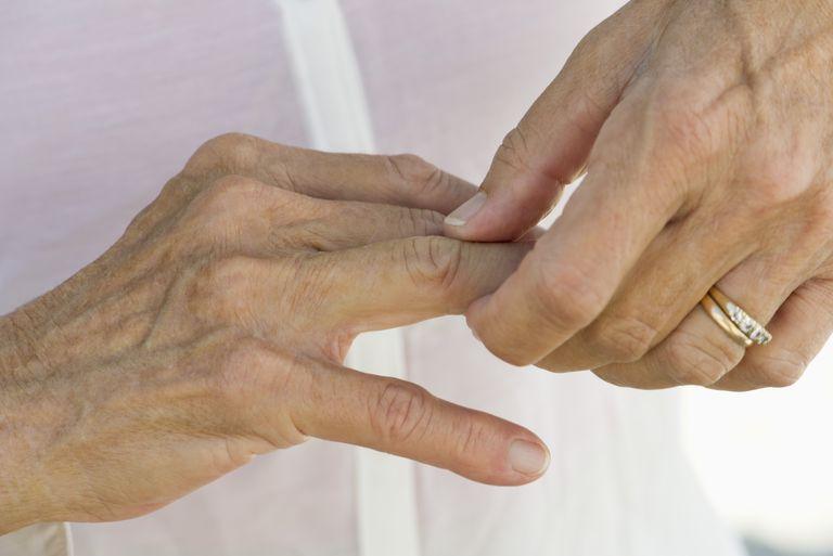 A woman massaging her jammed finger