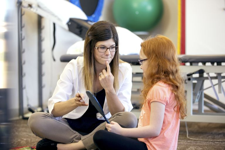 A speech therapist helping one of her patients