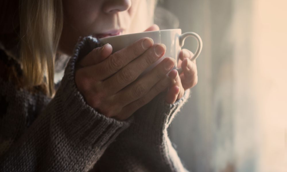 Close-Up Of Woman Drinking Tea