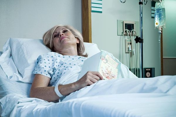 Mature woman lying in hospital bed