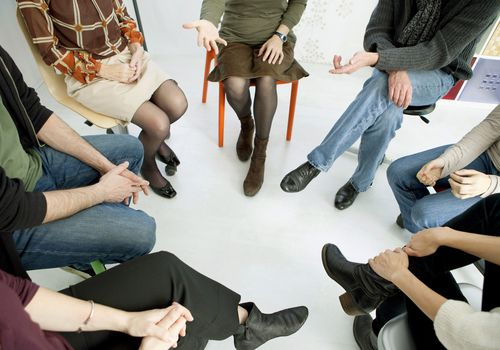 A support group sitting in a circle