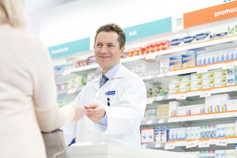 pharmacist handing out a prescription