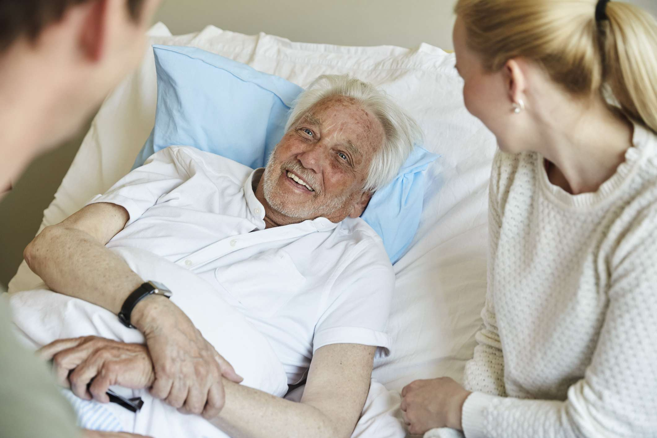 Man with stomach cancer in hospital bed