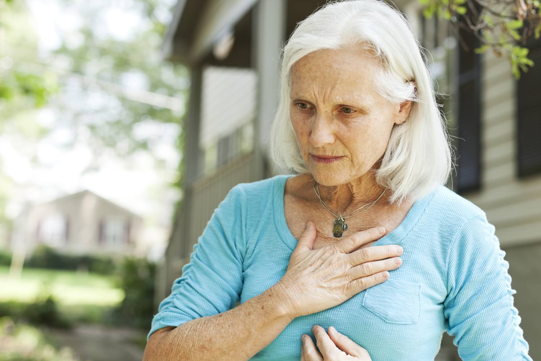 A woman suffering from heartburn