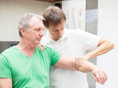 Physical therapist working on a man's osteoarthritis.