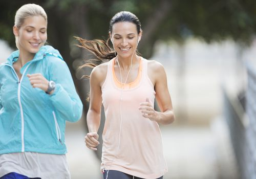 two women running together