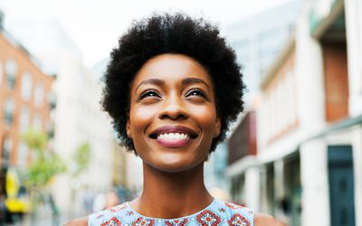 A smiling black woman standing outside, Living With and Coping With Headaches