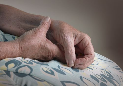 Woman rubbing her aching wrist