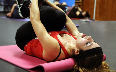 Female fitness instructor demonstrating stretching