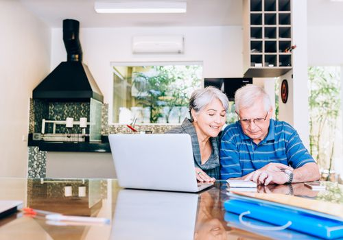 Senior couple reviewing finances