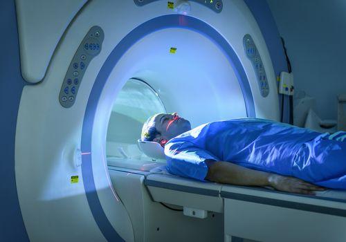 Man entering MRI scanning machine.