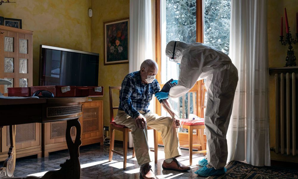 Photo of a man receiving care at home.