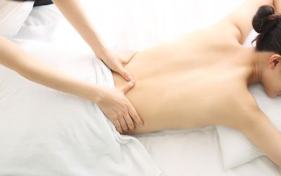 Woman with cancer receiving massage therapy