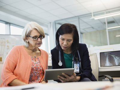 Doctor and patient looking at tablet together