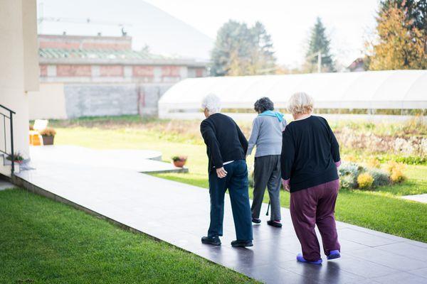 Group of elderly people walking outdoors