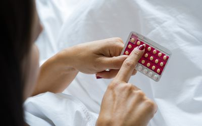 Woman checking date on her birth control