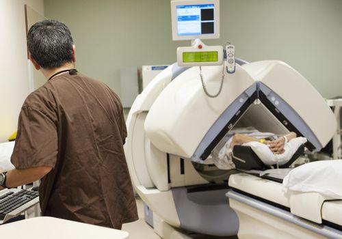 Radiologists prepares open mri scan