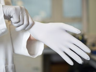 doctor putting on latex gloves