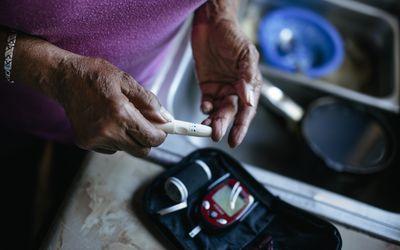 Senior woman checking blood sugar levels