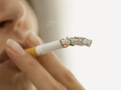 Close up of woman smoking a cigarette