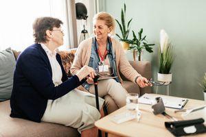 nurse visits patient at home