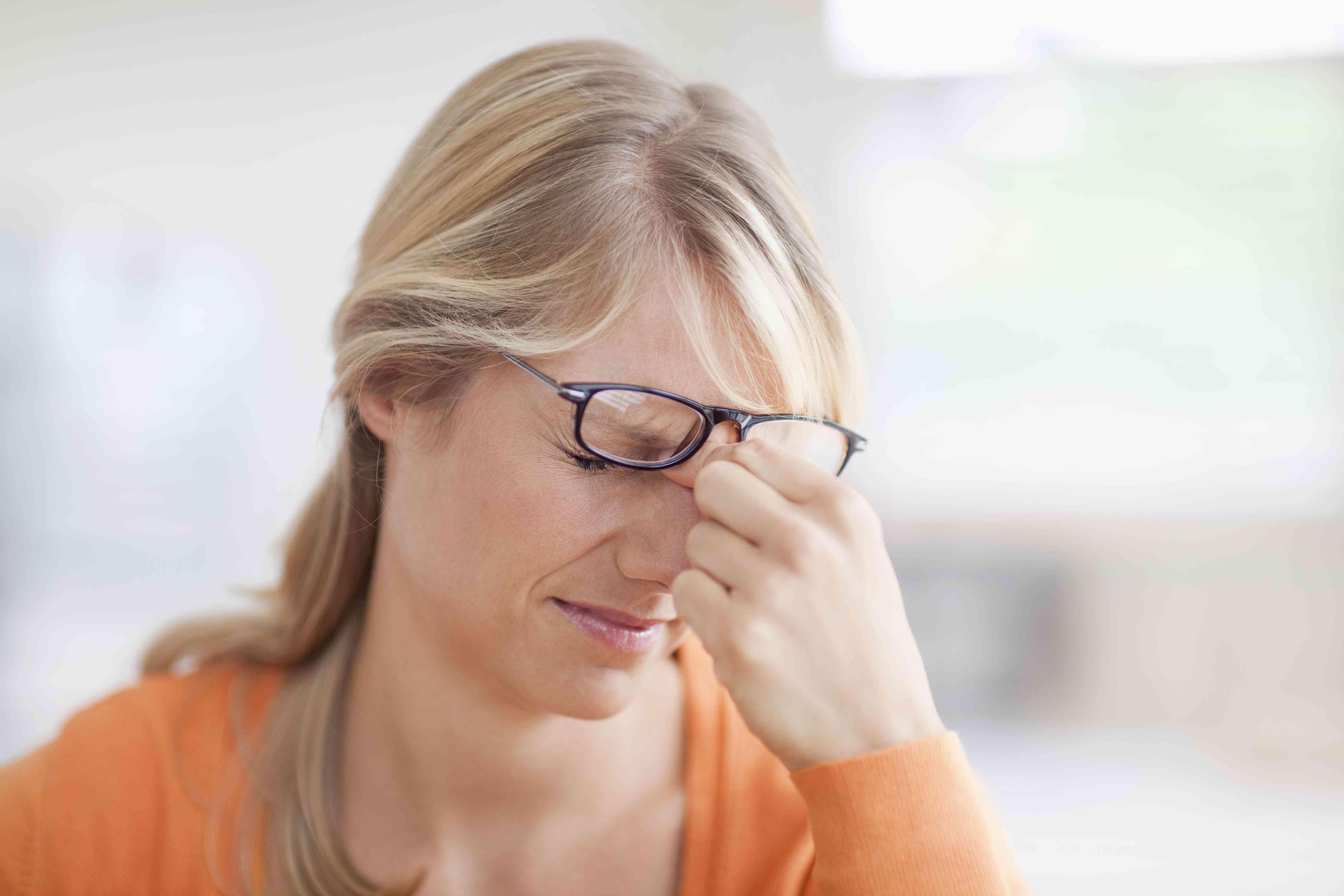 A woman with an extreme headache