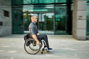 Candid Portrait of Businessman in Wheelchair on the Move