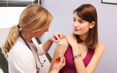Teen girl getting HPV vaccine