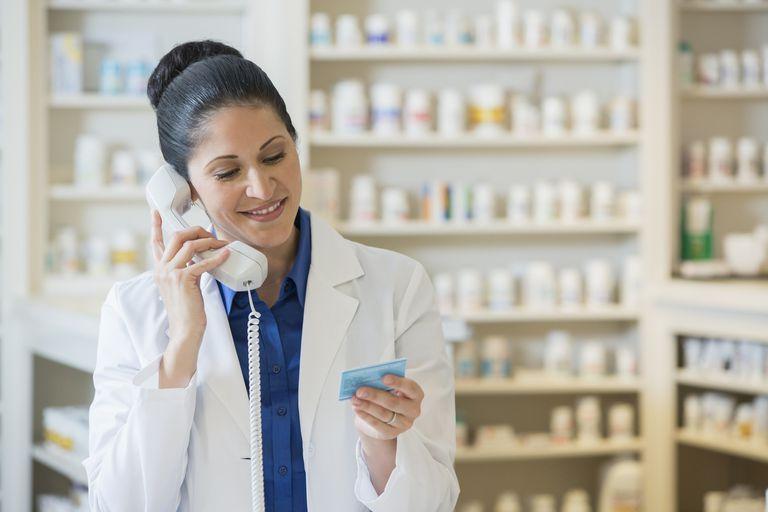 Hispanic pharmacist talking on telephone