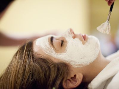 A woman getting an acne facial