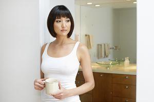concerned woman in bathroom