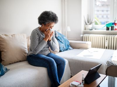 Sick woman having video call with doctor