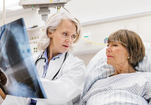 doctor talking to a patient about a pneumonectomy for lung cancer