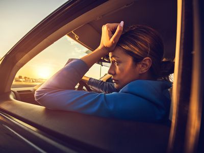 Sad woman in a car