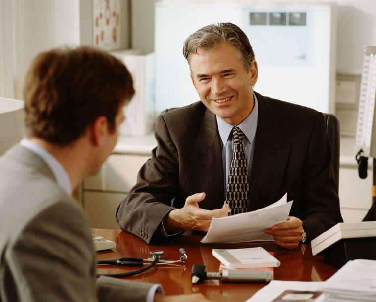 Health professionals meeting at a desk.